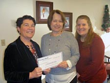 Jacquelyn Meekins, VP of Eastern Benefits (center), presented the check to OCES staff