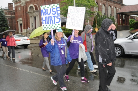 Abuse hurts sign at march