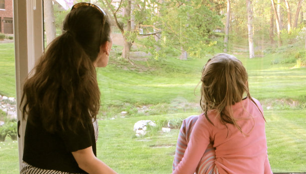 Lessons from my mother: mother daughter looking out window