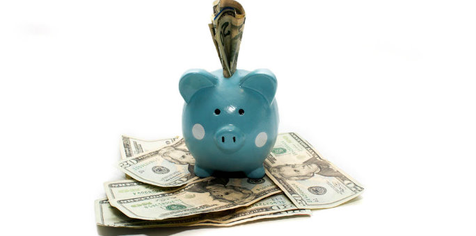 Save regularly putting money in piggy bank