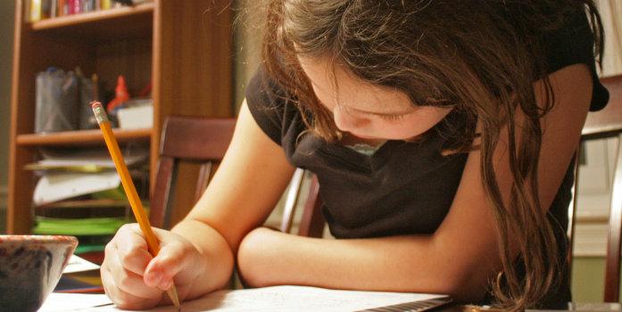 little girl writing letter