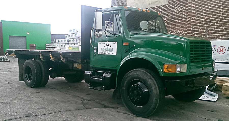 Woodland's '00 Army Green International flatbed truck