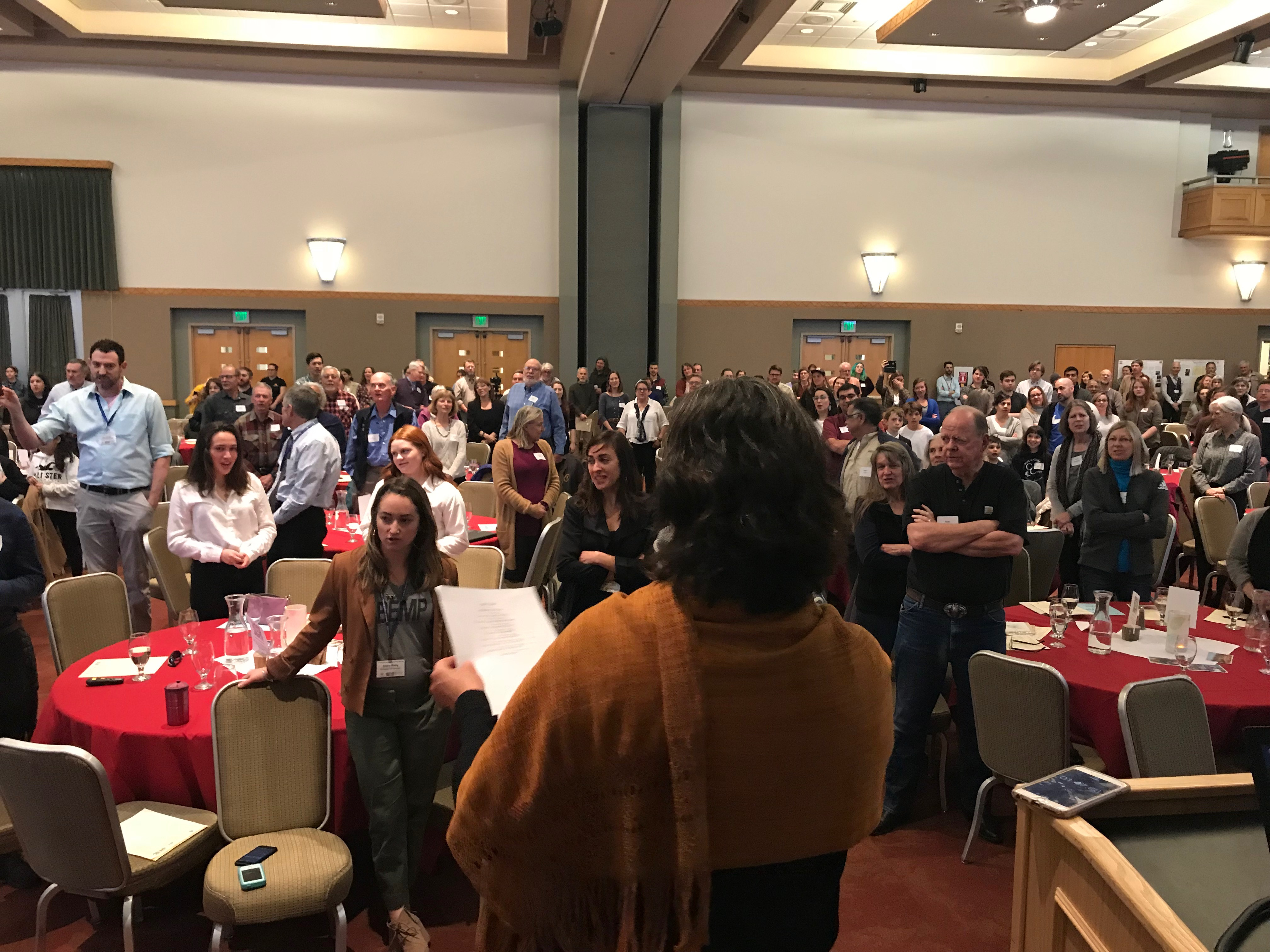 Crawford Symposium attendees participating in a poem with Albuquerque's Poet Laureate, Michelle Otero and Inez Elementary School BASS students.
