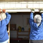 Linda and Tom 3fixing shed doors
