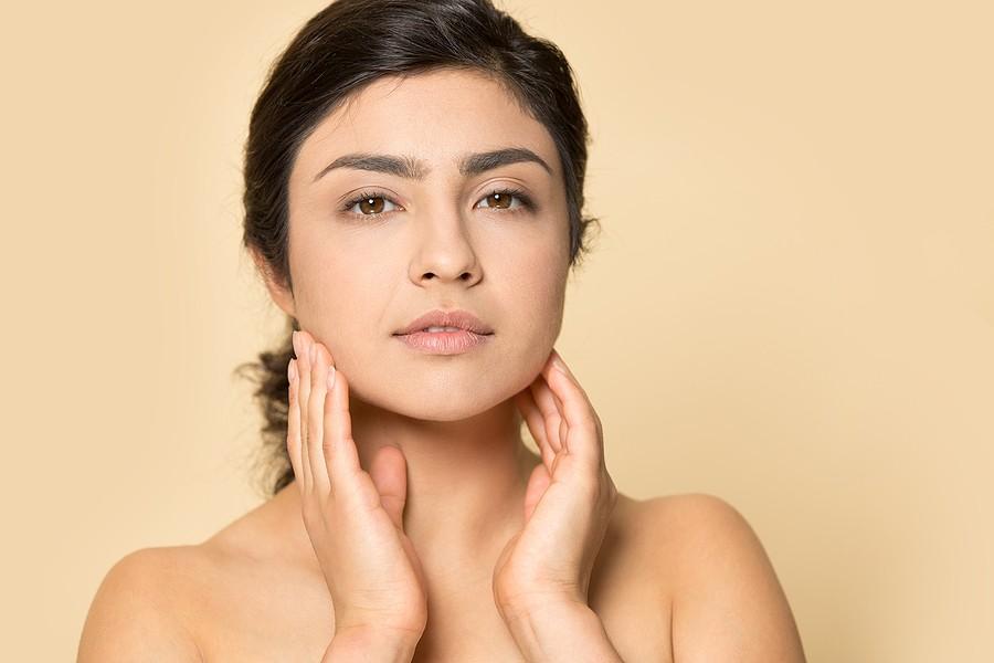 woman using evening primrose oil for skin