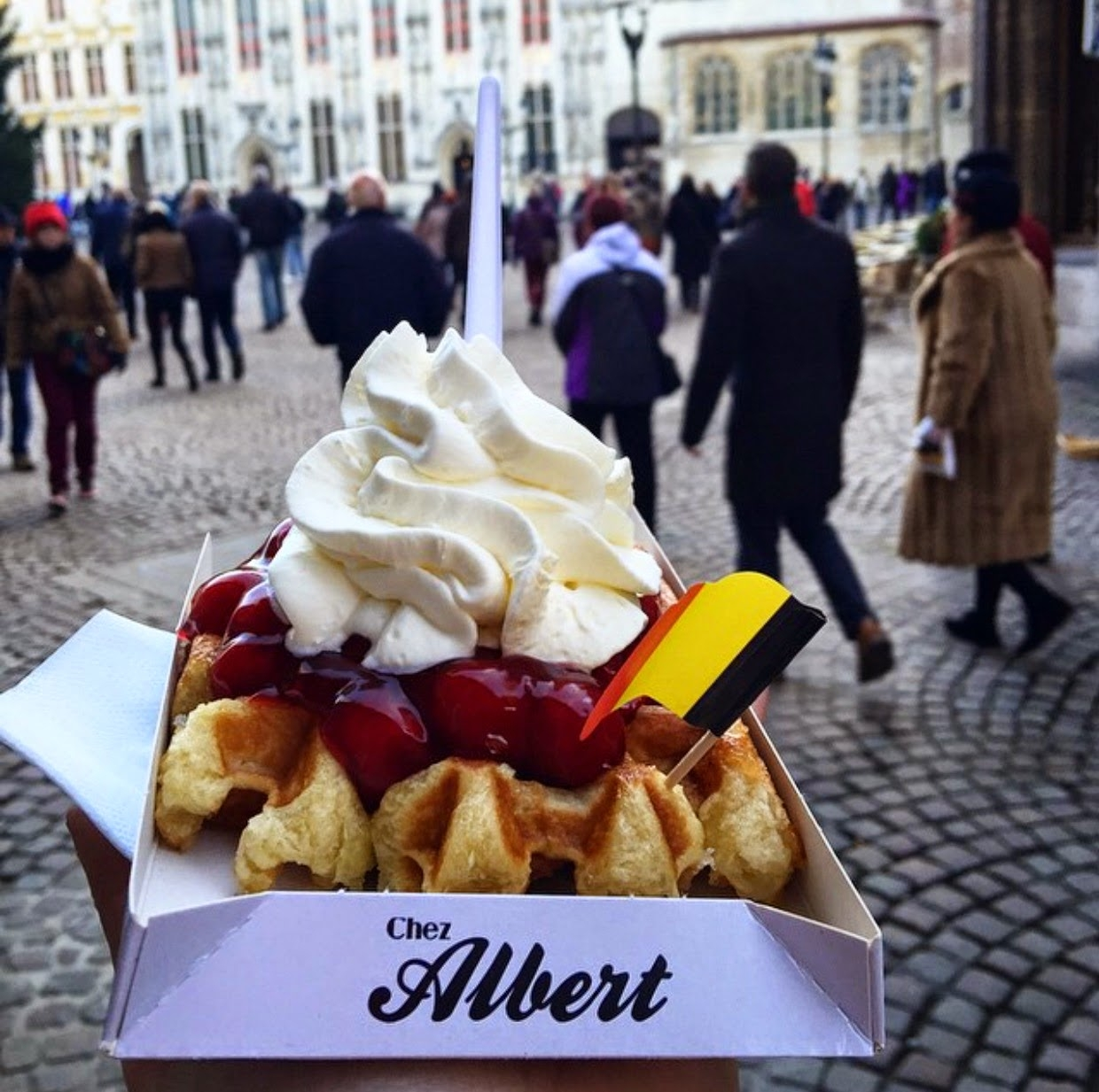 photo of waffles with cherries and cream