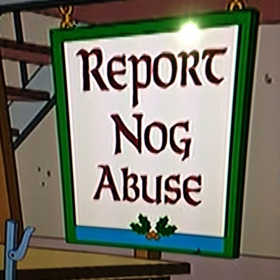 photo of cartoon sign saying 'report nog abuse'