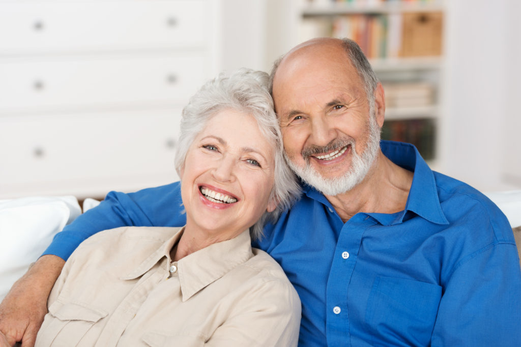 Elderly couple happy with their smile makeovers they received at Sound to Mountain Dental from Dr Hickey in Tacoma, WA.