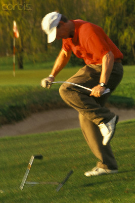 Golfer Breaking His Clubs