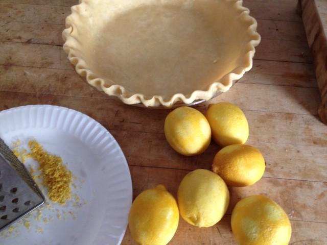 pie shell, lemons , grater