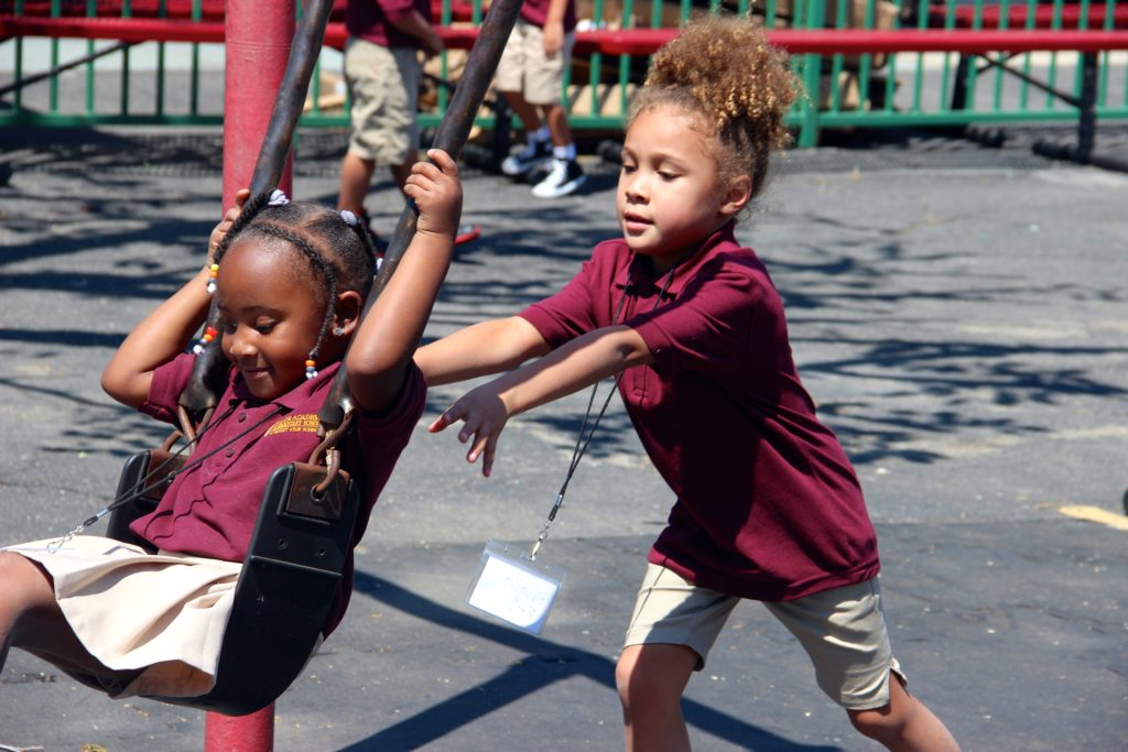 Our students are already becoming fast friends as they play together on the playground.