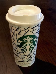"Starbucks cup embellished with the tangle Cyme. I used a Sharpie fine marker for the wide lines, and a Faber Castell permanent ""S"" for the finer lines. The shading was created with a Copic colorless marker which ""melted"" the existing lines so I could pull the diluted ink into the white areas."