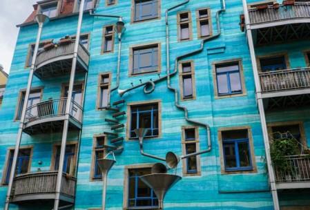 The building plays music. The music sounds similar to rain hitting aluminum.