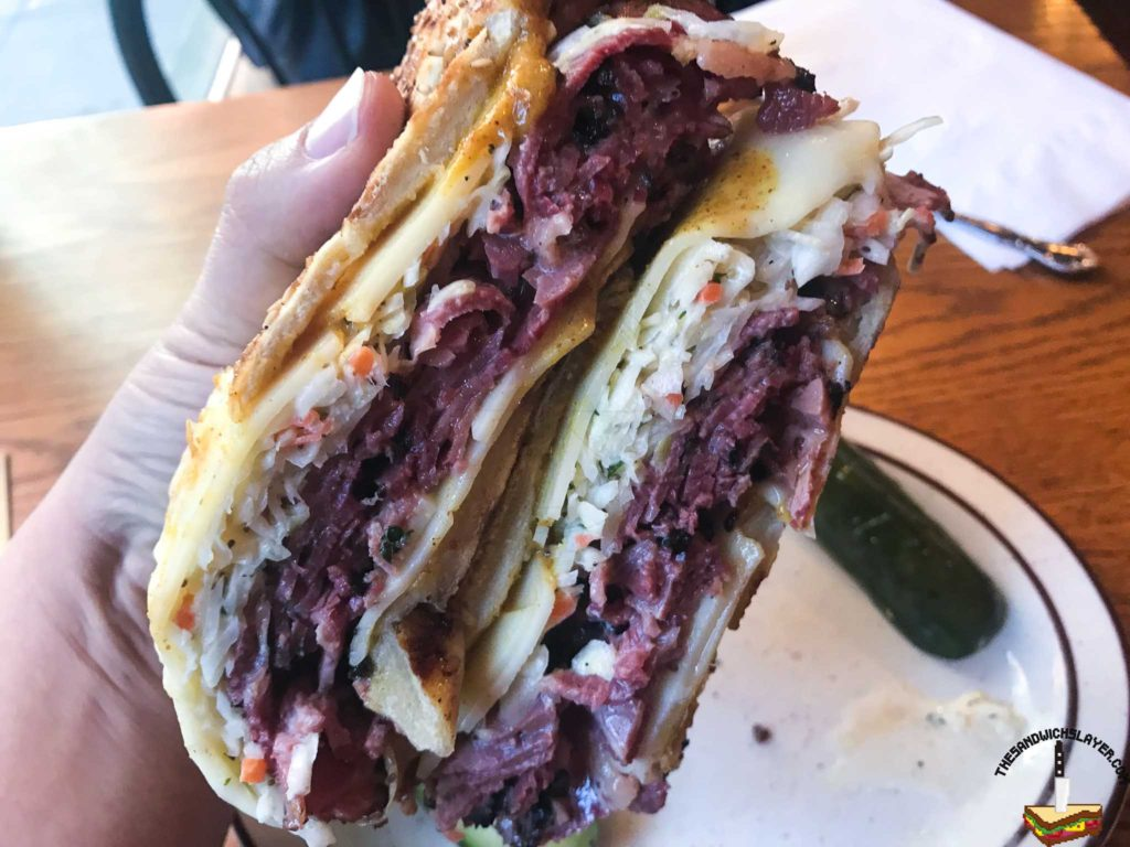 Rumanian Pastrami, Honey Chipotle mustard, slaw, and swiss cheese on a grilled sesame Italian roll