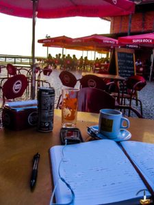 Writing in my journal outside a cafe in Olhao, Portugal. The author is a little emotional and really ego-centric.