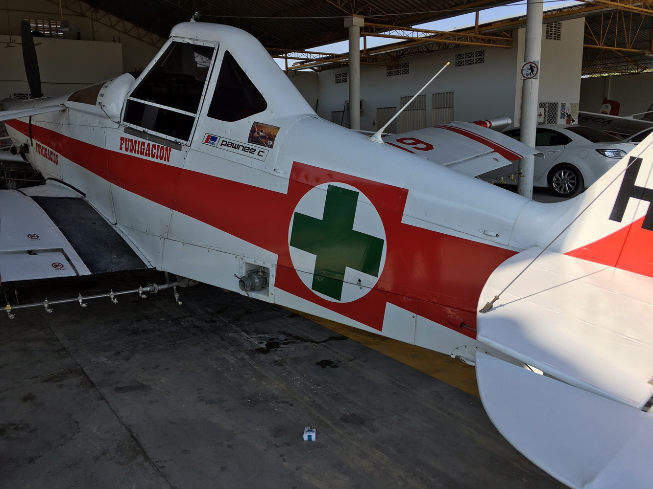 "The symbolic ""green cross"" is found on all of Sanidad Vegetal Cruz Verde's 11 Pawnee aircraft; the Red Cross for Colombian agriculture"