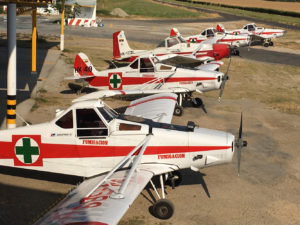 Four Sanidad Vegetal Pawnees parked at Agua Blanca with one of two Cessna C-188s in the middle of the line up