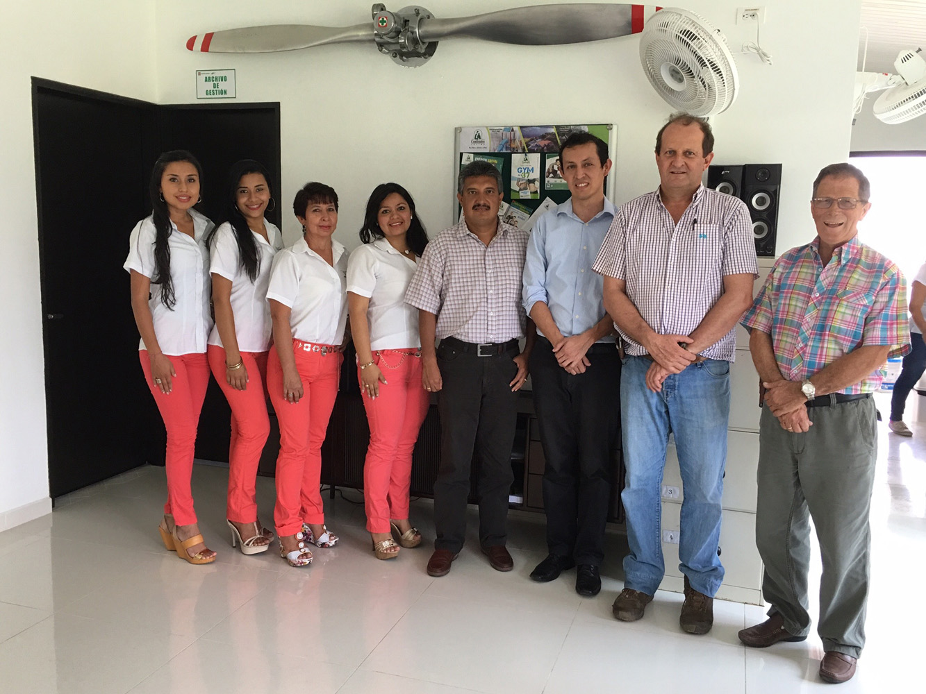 Sanidad Vegetal administrative personnel at the main office in Ibagué with General Manager Andres Klotz second from right and retired Chief Pilot Billy Griebling far right