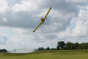 Grant Lane, Lane Aviation, makes a demonstration pass for local students.