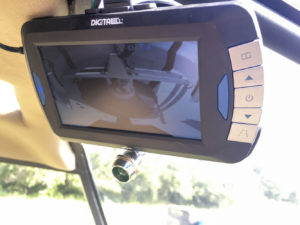 Quick-mount camera systems enable the R44 pilot to see when he is out of product. The camera is mounted inside the bucket.