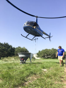 The Robinson R44 Raven II is used at 55 mph, with a bucket height of 20 feet above the canopy.
