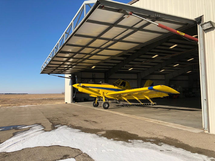 Agtegra Coop award-winning aerial spray hangar sports 70-foot drive-thru hydraulic doors from Schweiss