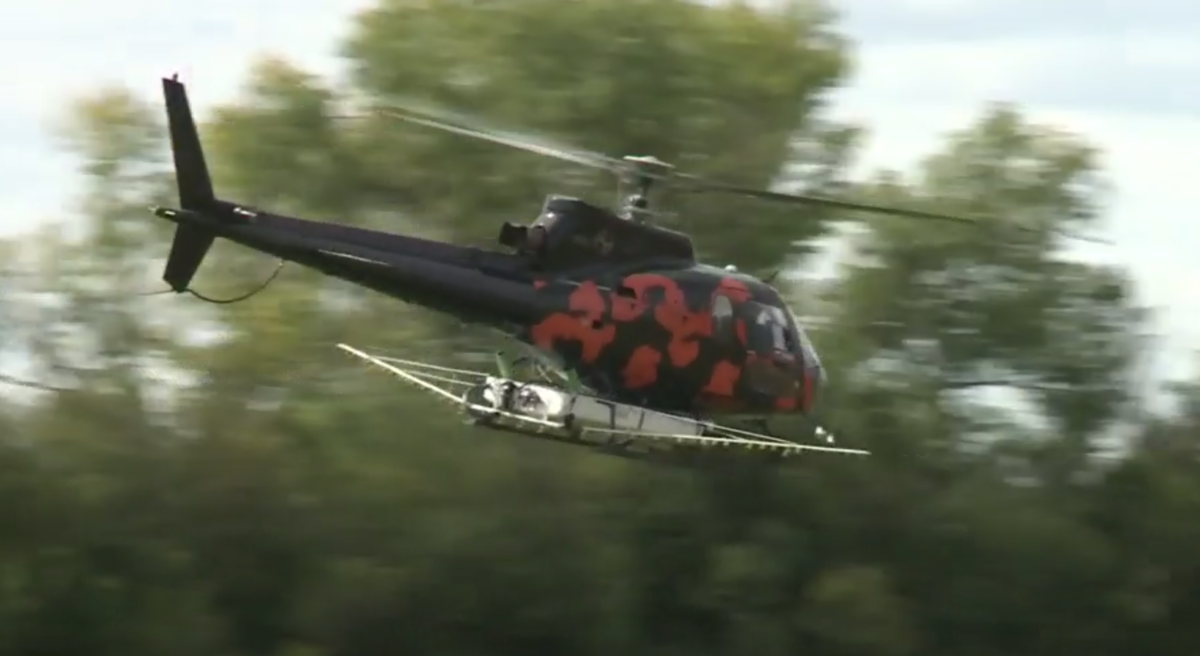 VIDEO: Crews use helicopter to spray field near Regina