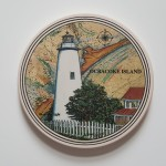 "Coasterstone featuring the Ocracoke Lighthouse, Cork backing and absorbant, approx 4"" in diameter"