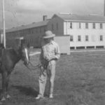 Commander Wilkinson with horse by Admin building on Ocracoke US Navt OPS Collection
