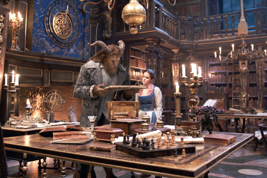 The Beast (Dan Stevens) and Belle (Emma Watson) in the castle library in Disney's BEAUTY AND THE BEAST, a live-action adaptation