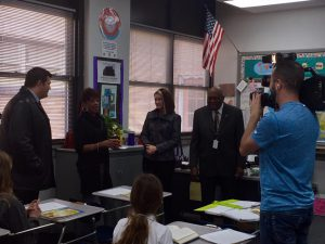 Jeana Dorsey receives the Teacher of the Year Award in her classroom at Carver Middle School: l to r Ron Terrell, Fox 23 News Anchor, Jeana Dorsey, Debra Gist, Tulsa Public Schools Superintendent, and Wilbert Collins, District 2 Tulsa Public School Board.