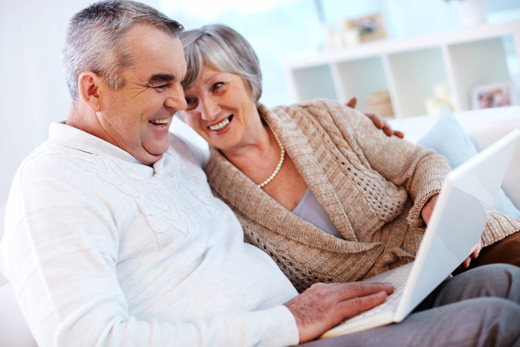 Man and Woman using a lap top