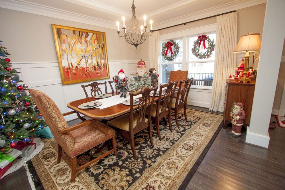 To the left of the entry, a handsome dining room features a beautiful mix of color and pattern.