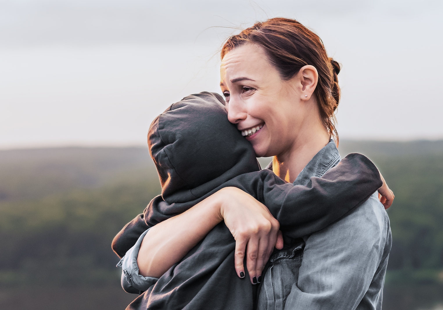Mom cries and hugs the child. The boy hugs his mother family values sad expression frustration resentment. Caring for the child grief in the family.