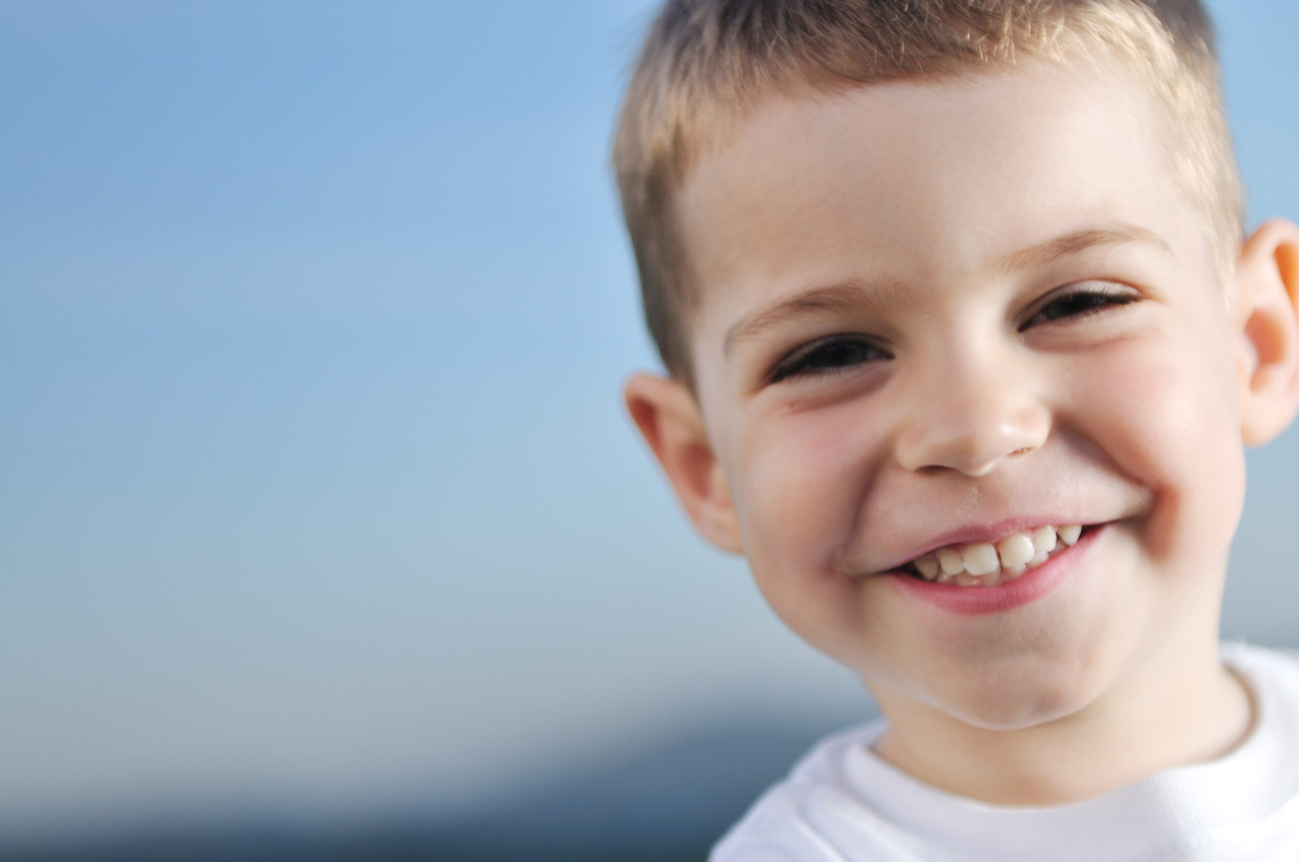 happy young boy child outdoor portrait