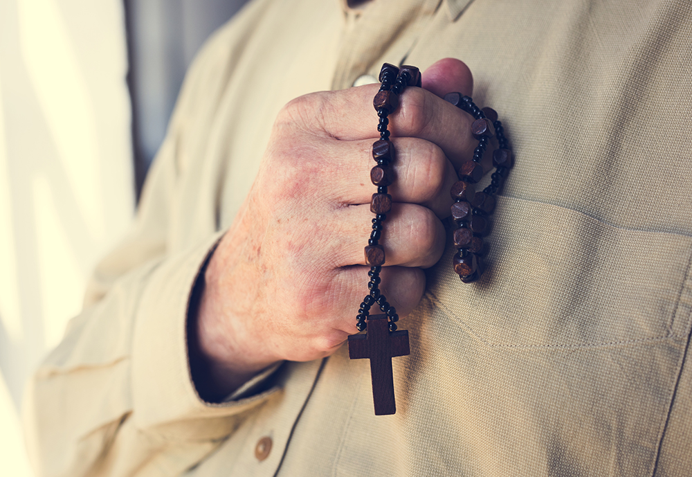 Hands holding cross prayer faith in christianity religion