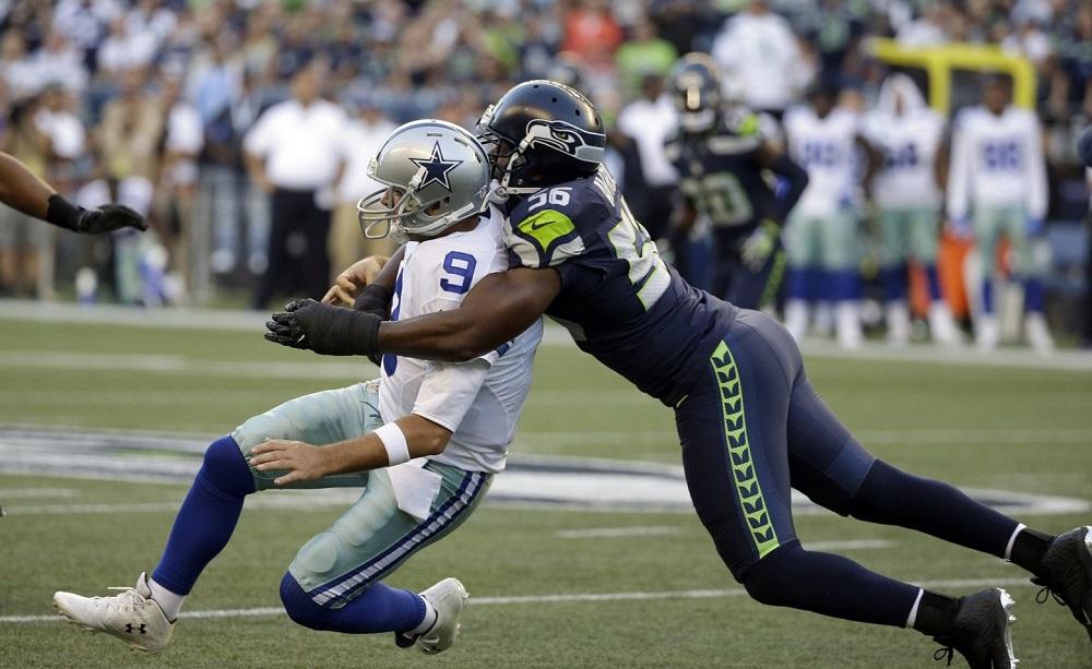 Romo injured while being tackled