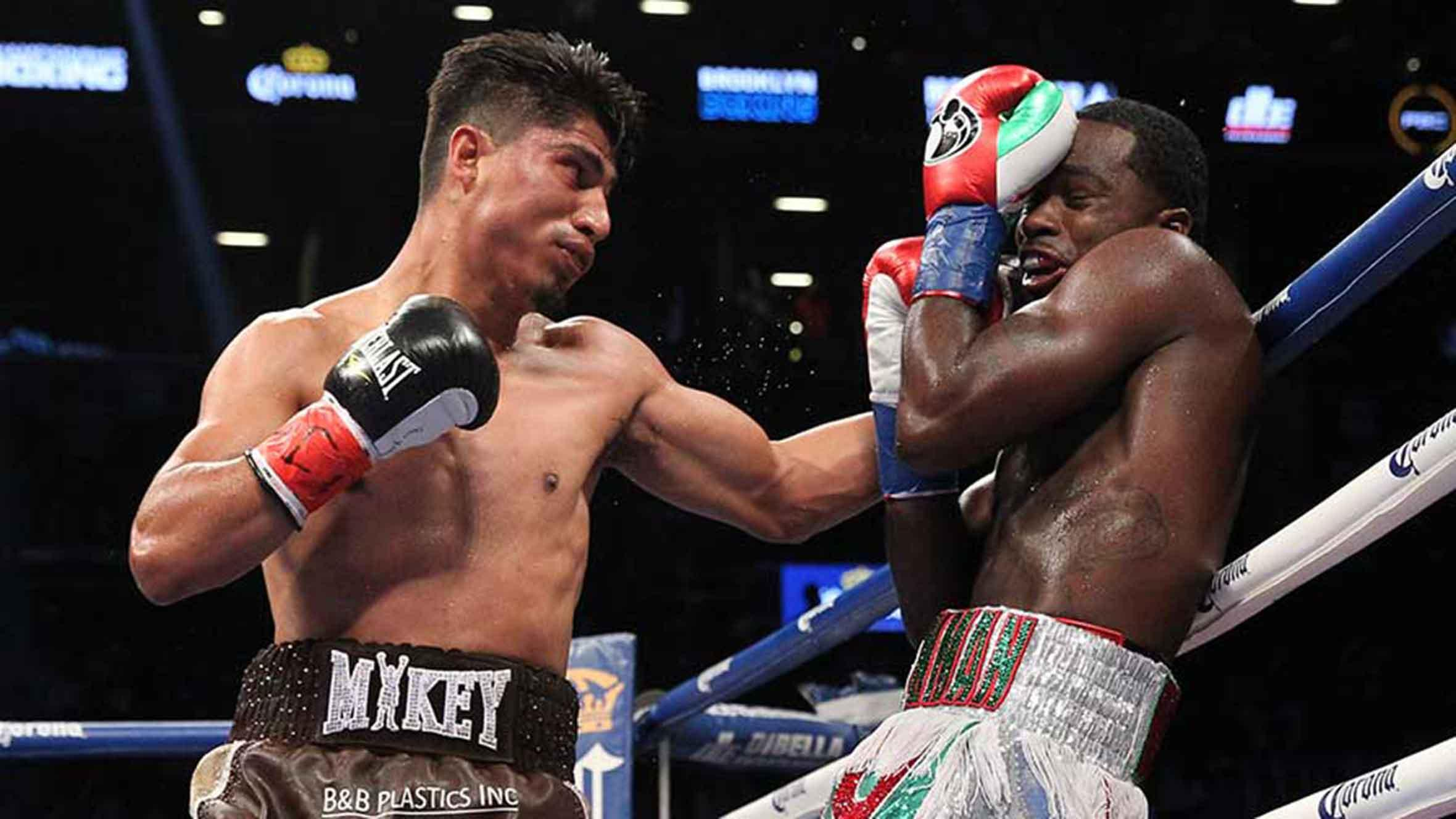 Mikey Garcia punching Adrien Broner