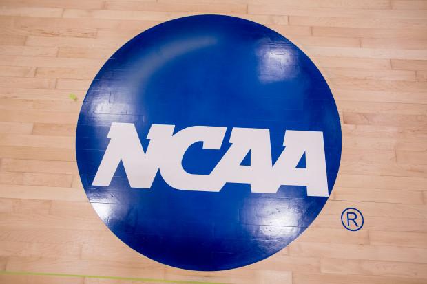NCAA logo on the court