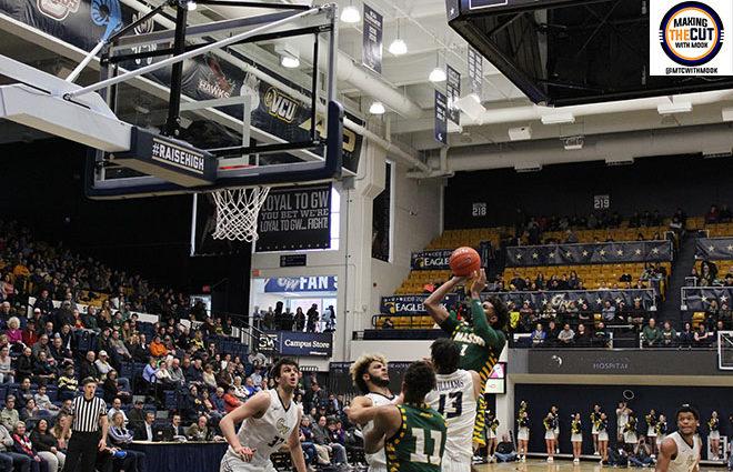 Justin Kier drives to the basket against George Washington. Photo Credit: Marcus Washington/Making The Cut