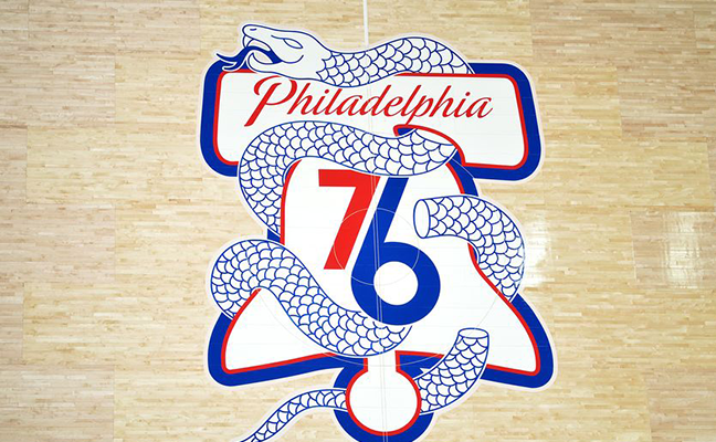 Sixers logo on their court