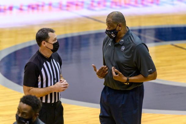 Patrick Ewing speaks to referee vs St. John's/Photo Credit: Rafael Suanes / Georgetown Athletics