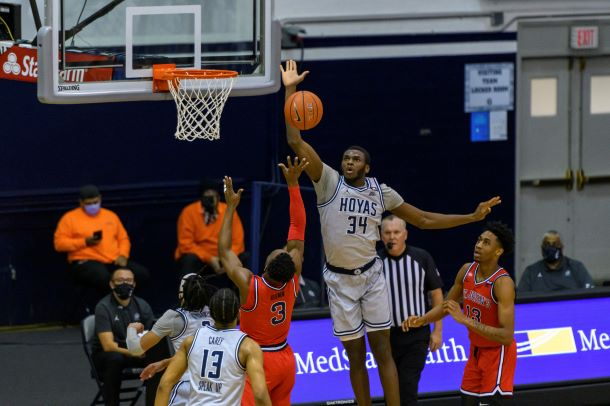 Qudus Wahab goes up for the block against St. John's