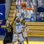 Jamorko Pickett finishes a layup vs Marquette. Photo Credit: Rafael Suanes / Georgetown Athletics.