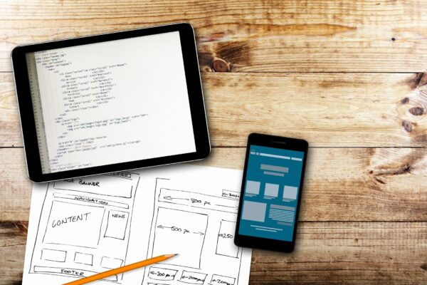 Ipad, iphone and sketch showing user interface wireframes