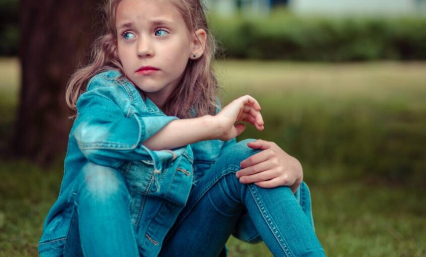 child on grass parental alienation - family law attorneys tampa