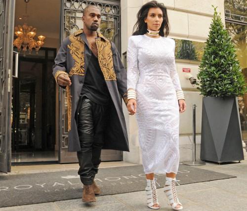 Kim Kardashian and Kanye West attending the Balmain show USA ONLY