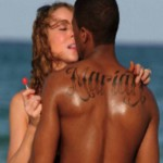 """Nick Cannon changes his """"Mariah"""" tattoo to Guess What?"""