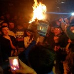 Kentucky fans light fires, burn cars on State Street after lost to Wisconsin.