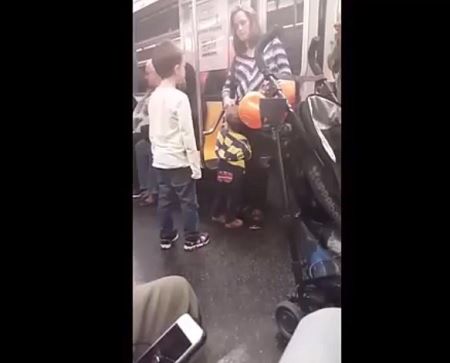 cell-phone-footage-shows-a-white-kid-on-a-nyc-train